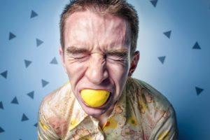 sucking on a lemon by man
