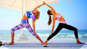 Yoga poses by two girls